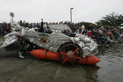 """Josh Jackson/The Times-Standard  """"Armored Carp"""" prepares to take to the water during the Humboldt Bay crossing section of the course in day two of the Kinetic Grand Championship."""