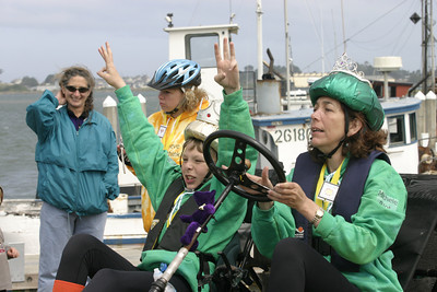 """Josh Jackson/The Times-Standard  Mason Estabrook, 13, celebrates a successful Bay crossing as his mother Michelle guides """"The Emperor's New Machine"""" to a pit stop during the Humboldt Bay crossing section of the course in day two of the Kinetic Grand Championship."""