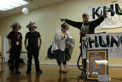 """Josh Jackson/The Times-Standard  Duane Flatmo and crew of """"Armored Carp"""" take the First Place Art Award at the Kinetic Grand Championship awards banquet at Fireman's Pavilion Ferndale on Monday."""