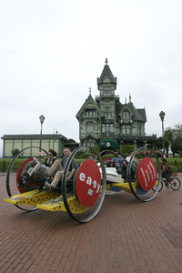 """Josh Jackson/The Times-Standard  The crew of """"Easy, That Was"""" makes the turn onto First Street at the Carson Mansion during day one of the Kinetic Grand Championship on Saturday."""
