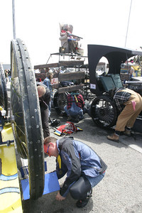 """Josh Jackson/The Times-Standard  The crews of """"Easy, That Was"""" and """"The Deliverance Truck"""" convert their vehicles from marine cruiser to road racer during the Humboldt Bay crossing section of the course in day two of the Kinetic Grand Championship."""