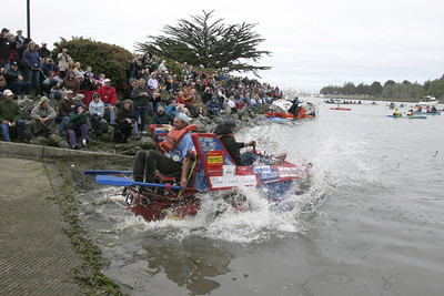 """Josh Jackson/The Times-Standard  """"Grampa"""" splashes into the water during the Humboldt Bay crossing section of the course in day two of the Kinetic Grand Championship."""