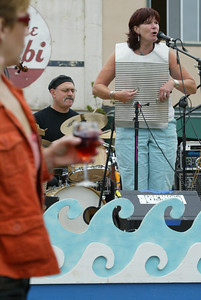 Shaun Walker/The Times-Standard  Kate Koelmel plays the rub board as Mike LaBolle keeps the beat for the Bayou Swamis.