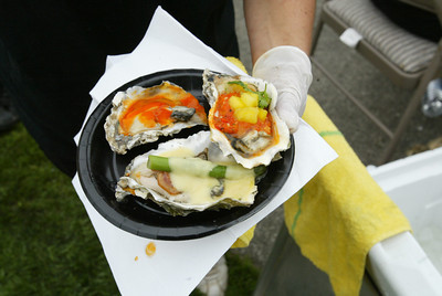 """Shaun Walker/The Times-Standard  Bear River Casino's """"oyster oscar"""", bottom, featured oyster barbecued with bacon, crab, garlic butter, asparagus, and Hollandaise sauce."""