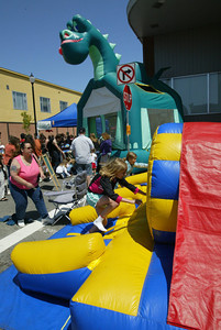 Shaun Walker/The Times-Standard  An inflatable obstacle course provided fun in the kids area.