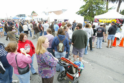 Shaun Walker/The Times-Standard  The lines for many oyster treats stretched back to the far sidewalk.