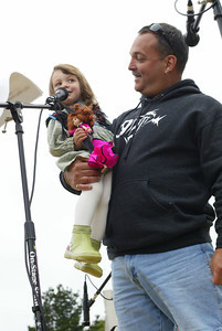 Shaun Walker/The Times-Standard  Emily Hiney, 2, of Eureka gets a lift from dad Michael during the oyster calling contest.