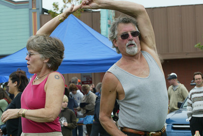 Shaun Walker/The Times-Standard  Sue and Peter Portugal of Eureka dance to the Bayou Swamis.