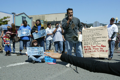 Shaun Walker/The Times-Standard  Fernando Paz of Arcata helped stage street theater about the recent local immigration raids and other immigrant and homeless issues during the festival.