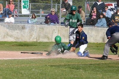 Josh Jackson/The Times-Standard  Dukes' Zach Wilkinson slides into home plate during Monday's game at Redwood Fields.