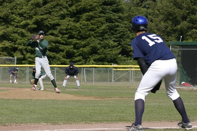 Josh Jackson/The Times-Standard  Dukes' pitcher Steven Nessler eyes Patiriots' Ryan Robertson as he leads off of third base during Monday's game at Redwood Fields.