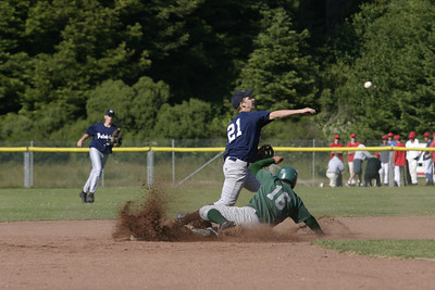 Josh Jackson/The Times-Standard  Dukes' Joey Gordon slides into second base as Patriots' Kalen Curtman throws to first during Monday's game at Redwood Fields.