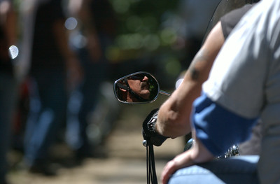 Mark McKenna/The Times-Standard  A riders face is caught in the mirror of his Harley-Davidson.