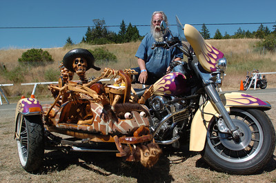 """Mark McKenna/The Times-Standard  John """"Teach"""" Girard of Eugene, Oregon is a Vietnam Veteran who lost both legs below his knees. That hasn't stopped him from riding. He carved all the wood work on his sidecar companion and has been in EZ Rider Magazine."""