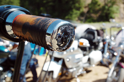 Mark McKenna/The Times-Standard  Motorcycles reflected in custom hand grips.