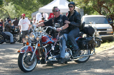 Mark McKenna/The Times-Standard L.T. Thomas and Carmela Williams rode in to the 30th annual Redwood Run on a1995 Heritage Harley-Davidson.