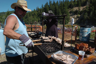 Mark McKenna/The Times-Standard South Fork Boosters Gilbert Traylor, left, and Brad Thrasher have been cooking ribs at the Redwood Run for roughly a decade.