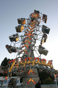 Josh Jackson/The Times-Standard  Lights glow on the midway rides at the Redwood Acres Fair and Rodeo on Friday.