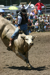 Josh Jackson/The Times-Standard Monty Shack rides in the bullriding event in the CCPRA Rodeo at the Redwood Acres Fair and Rodeo on Saturday.