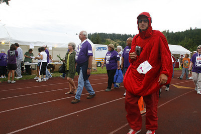 Josh Jackson/The Times-Standard  Jeff Sousa makes laps dressed as a blood polyph duing the 2007 Relay for Life at College of the Redwoods on Friday.