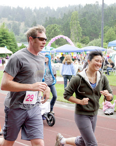 Shaun Walker/The Times-Standard  David and Patricia run at Humboldt Relay for Life 2012 on Saturday.