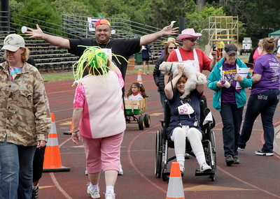 Shaun Walker/The Times-Standard  A man offers a hug to a Relay cohort as people do their laps at Humboldt Relay for Life 2012 on Saturday.