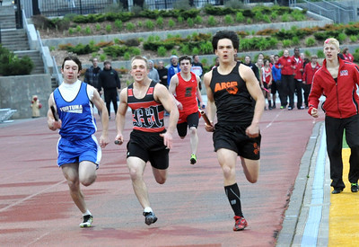 JosŽ Quezada/For the Times-Standard  Skyler Rigley of Arcata High School, far right, takes the lead in the boys 4 x 200 relay in the last 50 meters of the race. Josh Jorgenson of Fortuna High School, far left, took second place, and Laine Grace of McKionleyville High School, middle, took third place. Henry Smith of Eureka High School finished fourth in the race decided in the final moments.