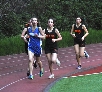 JosŽ Quezada/For the Times-Standard  Husky Michaela Barros of Fortuna High takes the lead over a pack of Arcata High Tigers in the final lap of the 1600m race.