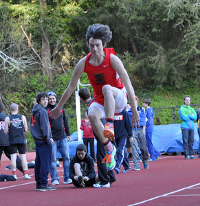 "JosŽ Quezada/For the Times-Standard  Freshman Ethan Savage of Eureka High School jumps a personal best 15' 7"" in the long jump competition."