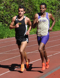 José Quezada/For the Times-Standard  HSU's Brent Ritchel passes Bruk Assefa of San Francisco State at the northern turn of the track to win the Men's 3000m.