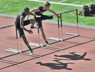 José Quezada/For the Times-Standard  HSU's Teigan Eilers, Sophmore, right, and Fred Rosser, a junior in his first year competing in track were tied for first taking on the last set of hurdles in the Men's 110m Hurdles.