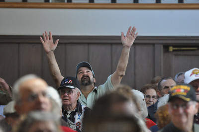 "José Quezada/For the Times-Standard  A veteran exalts during a stirring sing-a-long led by Mike Gibbs. A salute to veterans, ""Silent Heroes"" was presented by Fortuna Senior Services at the Fortuna Veterans Hall on Sunday."