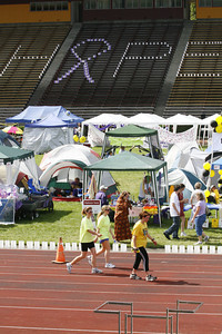 Josh Jackson/The Times-Standard  Teams make laps during the final day of the 2007 Relay for Life at College of the Redwoods on Saturday.