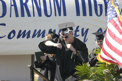 Josh Jackson/The Times-Standard  Chris Watson throws celebratory punches as he walks to the podium to receiving his diploma during the Zoe Barnum High School graduation on Wednesday.