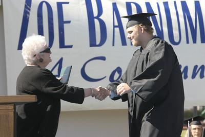 Josh Jackson/The Times-Standard  Joshua Miles receives his diploma during the Zoe Barnum High School graduation on Wednesday.