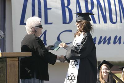 Josh Jackson/The Times-Standard  Brandy Nelson receives her diploma during the Zoe Barnum High School graduation on Wednesday.