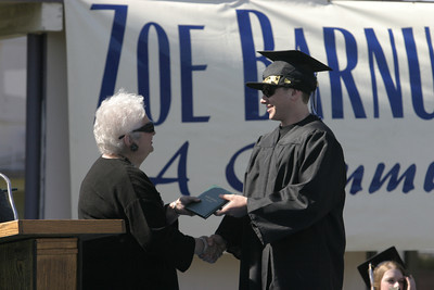Josh Jackson/The Times-Standard  Devin Harrison receives his diploma during the Zoe Barnum High School graduation on Wednesday.