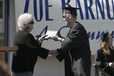 Josh Jackson/The Times-Standard  Chris Watson receives his diploma during the Zoe Barnum High School graduation on Wednesday.