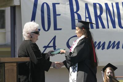 Josh Jackson/The Times-Standard  Camelia Gensaw-Kaye receives her diploma during the Zoe Barnum High School graduation on Wednesday.