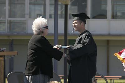 Josh Jackson/The Times-Standard  T.J. Elgin receives his diploma during the Zoe Barnum High School graduation on Wednesday.