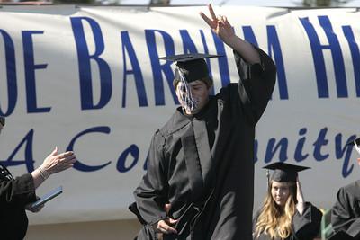 Josh Jackson/The Times-Standard  Julian Raygoza receives his diploma during the Zoe Barnum High School graduation on Wednesday.