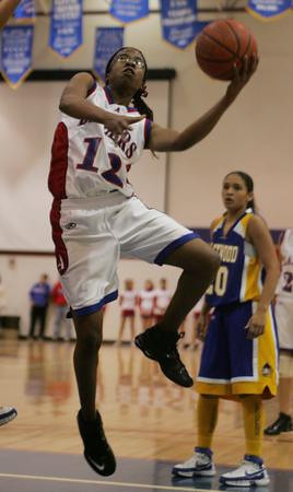 America's #12 Teisha King shoots for 2 points at the Trailblazers meet the Eastwood Troopers.  0126_c1_BB-Americas-Eastwood 1_aj photo by Adriane Jaeckle