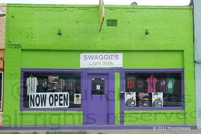 Bright green store front with a purple door - OK.