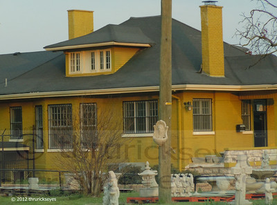 A brick house painted mustard yellow to sell lawn ornaments and statuary, what can I say?