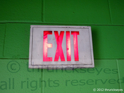 The green wall and red letters of the exit sign got my attention.
