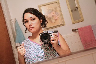 I wanted a picture of me in Grandma's apron, I remember her wearing this one a lot :)   yeah the bobby pins were necessary, I was getting masa in my hair.