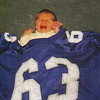 Jacob at birth in his daddy's famous #63 football jersey from White House High School