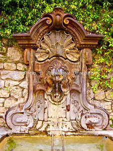 Fountain at entrance of Mougins, a village inland of Nice, France 2010
