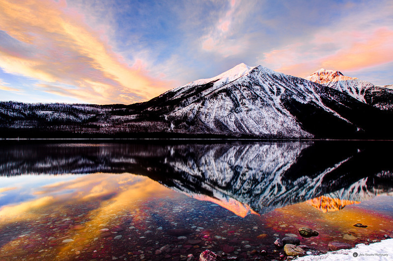 Winter sunset reflection of Mount Vaught on Lake McDonald in Glacier National Park
