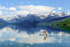 Dad and his son paddleboarding on Lake McDonald in Glacier National Park